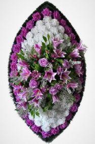 Фото - Ритуальный венок из искусственных цветов - Элитный #25 фиолетово-белый из лилий, гвоздик и зелени