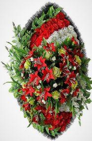 Фото - Ритуальный венок из искусственных цветов - Элитный #28 красно-белый из лилий и гвоздик