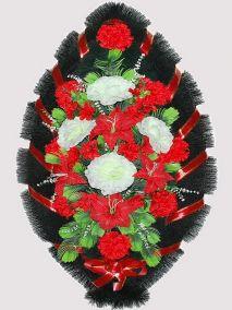 Фото - Ритуальный венок из искусственных цветов #12 красно-белый из лилий, гвоздик и зелени
