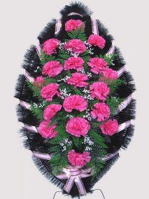 Фото - Ритуальный венок из искусственных цветов #28 розовый из гвоздик и зелени