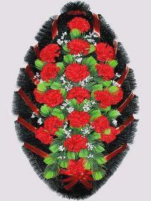 Фото - Ритуальный венок из искусственных цветов #4 красный из гвоздик и зелени