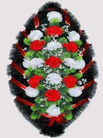 Фото - Ритуальный венок из искусственных цветов #8 красно-белый из гвоздик и зелени