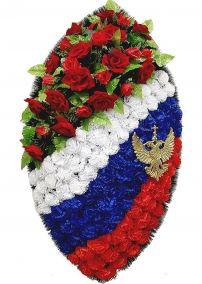 Фото - Ритуальный венок на возложение #11 Триколор из гвоздик с гербом и красные розы